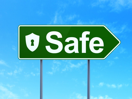 Safety concept: Safe and Shield With Keyhole icon on green road (highway) sign, clear blue sky background, 3d render photo