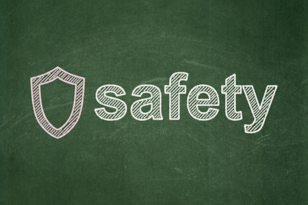contoured: Concepto de seguridad: contorneada Shield icono y texto de seguridad en el fondo verde de la pizarra, 3d Foto de archivo