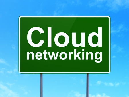 Cloud technology concept: Cloud Networking on green road (highway) sign, clear blue sky background, 3d render photo
