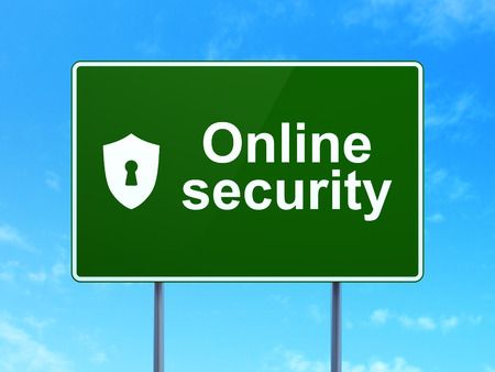Safety concept: Online Security and Shield With Keyhole icon on green road (highway) sign, clear blue sky background, 3d render Stock Photo - 27772037