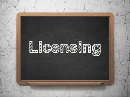 licensing: Law concept: text Licensing on Black chalkboard on grunge wall background, 3d render