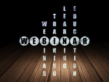 Education concept: Glowing word Webinar in solving Crossword Puzzle in grunge dark room with Wooden Floor, black background, 3d render photo
