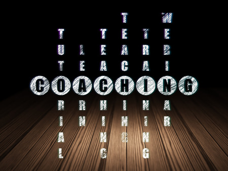 Education concept: Glowing word Coaching in solving Crossword Puzzle in grunge dark room with Wooden Floor, black background, 3d render photo