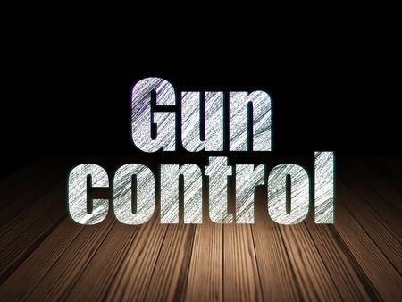 gun room: Privacy concept: Glowing text Gun Control in grunge dark room with Wooden Floor, black background