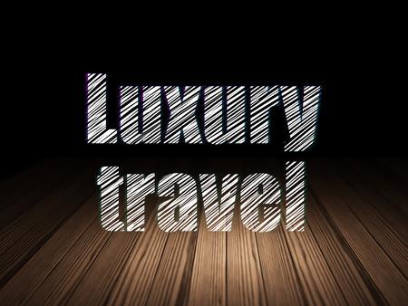 luxury travel: Travel concept: Glowing text Luxury Travel in grunge dark room with Wooden Floor, black background
