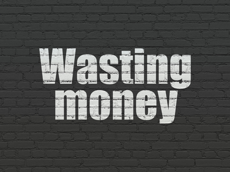 wasting: Banking concept: Painted white text Wasting Money on Black Brick wall background
