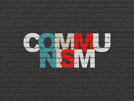 communism: Political concept: Painted multicolor text Communism on Black Brick wall background