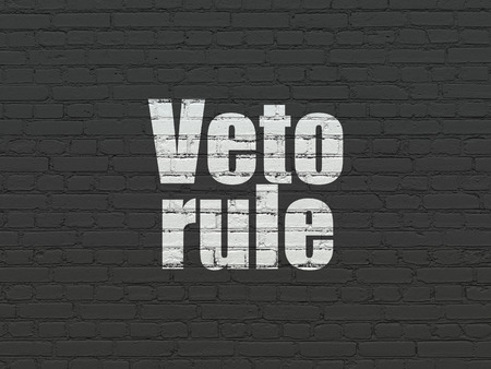 veto: Politics concept: Painted white text Veto Rule on Black Brick wall background