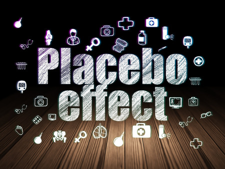 placebo: Healthcare concept: Glowing text Placebo Effect,  Hand Drawn Medicine Icons in grunge dark room with Wooden Floor, black background