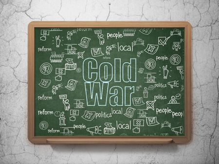 cold war: Politics concept: Chalk Blue text Cold War on School Board background with  Hand Drawn Politics Icons Stock Photo