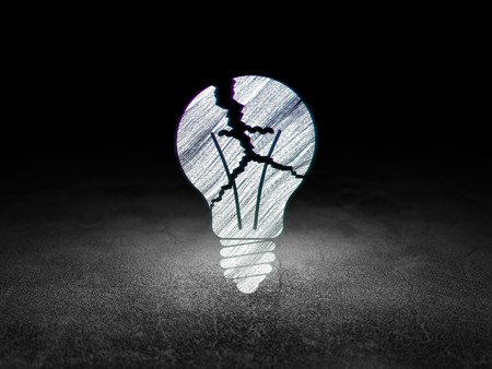 broken strategy: Business concept: Glowing Light Bulb icon in grunge dark room with Dirty Floor, black background