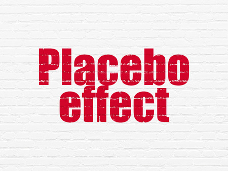 placebo: Healthcare concept: Painted red text Placebo Effect on White Brick wall background