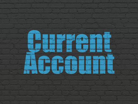 current account: Banking concept: Painted blue text Current Account on Black Brick wall background Stock Photo