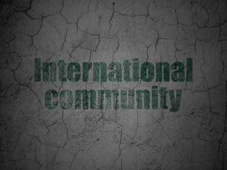 dictatorship: Politics concept: Green International Community on grunge textured concrete wall background