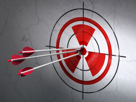 bullseye: Success Science concept: arrows hitting the center of Red Radiation target on wall background