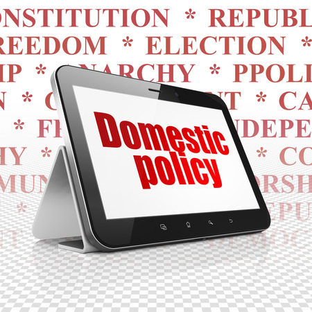 domestic policy: Politics concept: Tablet Computer with  red text Domestic Policy on display,  Tag Cloud background Stock Photo