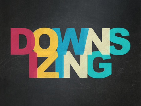 downsizing: Business concept: Painted multicolor text Downsizing on School Board background