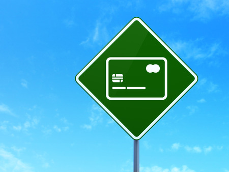 way bill: Currency concept: Credit Card on green road (highway) sign, clear blue sky background, 3d render Stock Photo