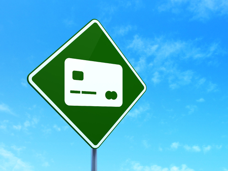 way bill: Banking concept: Credit Card on green road (highway) sign, clear blue sky background, 3d render Stock Photo