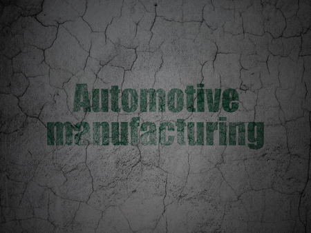 automotive industry: Industry concept: Green Automotive Manufacturing on grunge textured concrete wall background Stock Photo
