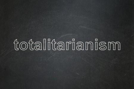 totalitarianism: Political concept: text Totalitarianism on Black chalkboard background