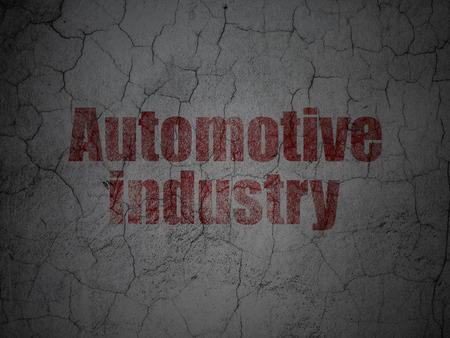 automotive industry: Manufacuring concept: Red Automotive Industry on grunge textured concrete wall background