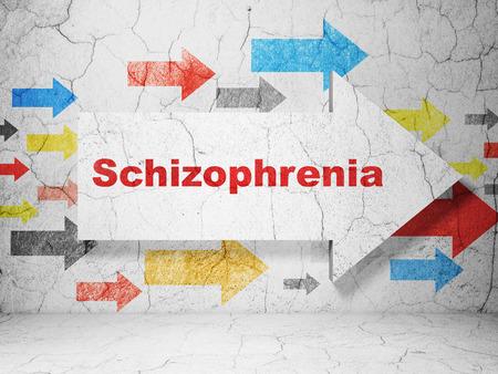 esquizofrenia: Concepto de la salud: flecha con esquizofrenia en el grunge con textura de fondo muro de hormigón