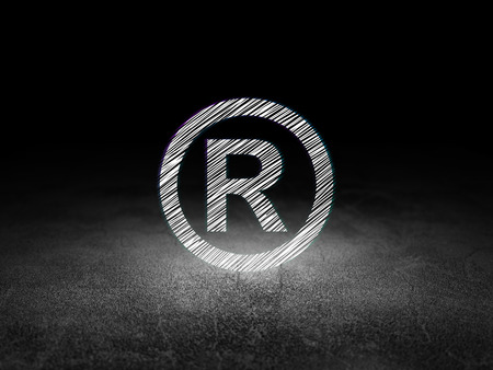 r regulation: Law concept: Glowing Registered icon in grunge dark room with Dirty Floor, black background