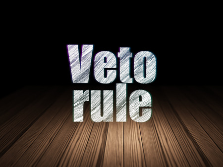 veto: Politics concept: Glowing text Veto Rule in grunge dark room with Wooden Floor, black background