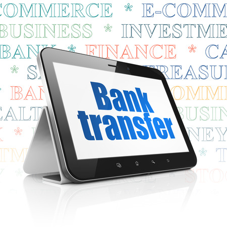 bank overschrijving: Banking concept: Tablet Computer with  blue text Bank Transfer on display,  Tag Cloud background