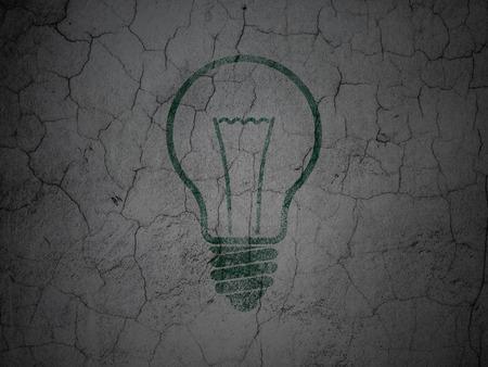 green light bulb: Finance concept: Green Light Bulb on grunge textured concrete wall background