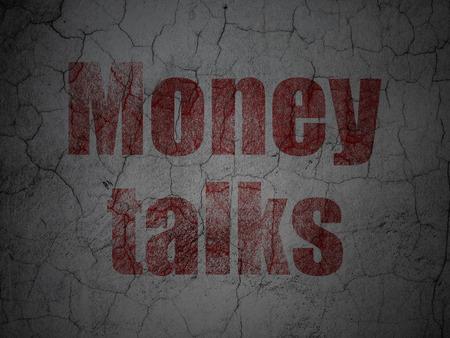 talks: Finance concept: Red Money Talks on grunge textured concrete wall background