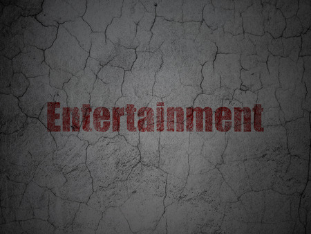 glade: Entertainment, concept: Red Entertainment on grunge textured concrete wall background Stock Photo
