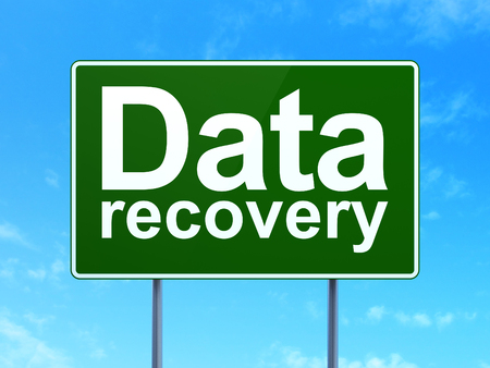 data recovery: Data concept: Data Recovery on green road (highway) sign, clear blue sky background, 3d render Stock Photo