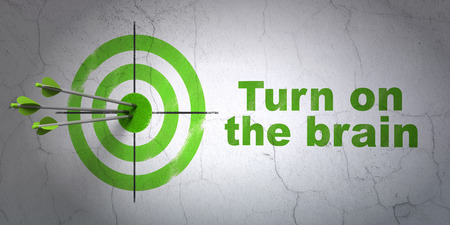 bullseye: Success Learning concept: arrows hitting the center of target, Green Turn On The Brain on wall background