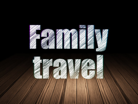 text room: Vacation concept: Glowing text Family Travel in grunge dark room with Wooden Floor, black background