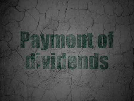 dividends: Currency concept: Green Payment Of Dividends on grunge textured concrete wall background