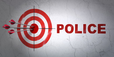 hitting a wall: Success law concept: arrows hitting the center of target, Red Police on wall background Stock Photo