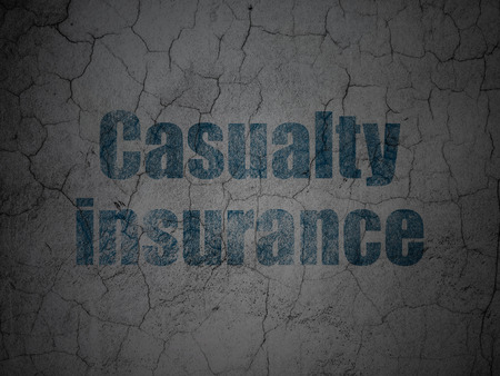 casualty: Insurance concept: Blue Casualty Insurance on grunge textured concrete wall background Stock Photo