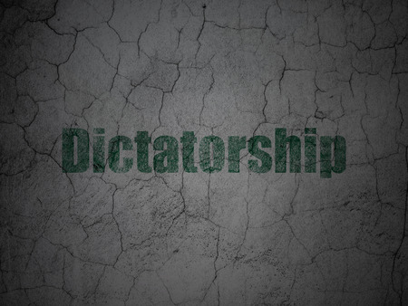 dictatorship: Political concept: Green Dictatorship on grunge textured concrete wall background