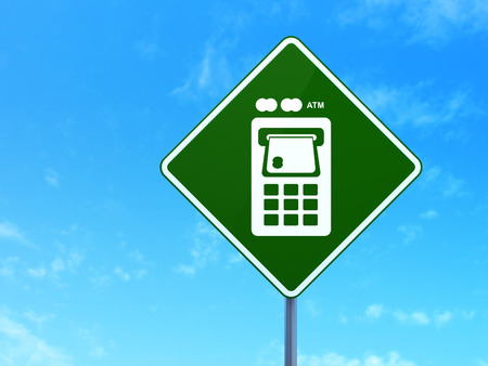 way bill: Money concept: ATM Machine on green road (highway) sign, clear blue sky background, 3d render