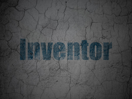 inventor: Science concept: Blue Inventor on grunge textured concrete wall background Stock Photo