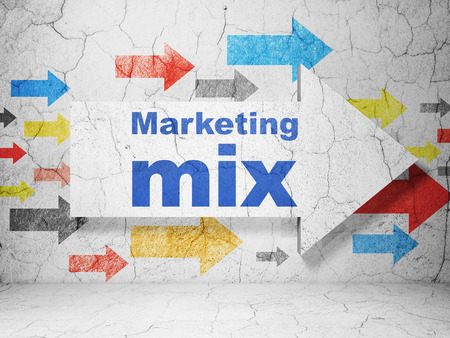 marketing mix: Advertising concept:  arrow with Marketing Mix on grunge textured concrete wall background