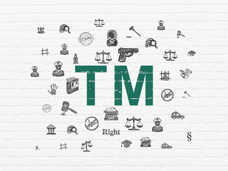 Law concept: Painted green Trademark icon on White Brick wall background with  Hand Drawn Law Icons Stock Photo