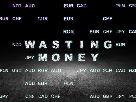 wasting: Money concept: Glowing text Wasting Money in grunge dark room with Dirty Floor, black background with Currency