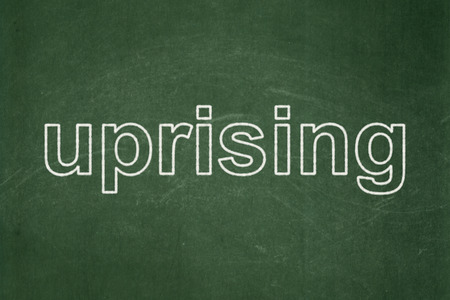 uprising: Political concept: text Uprising on Green chalkboard background Stock Photo