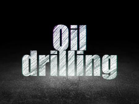 dirty room: Manufacuring concept: Glowing text Oil Drilling in grunge dark room with Dirty Floor, black background