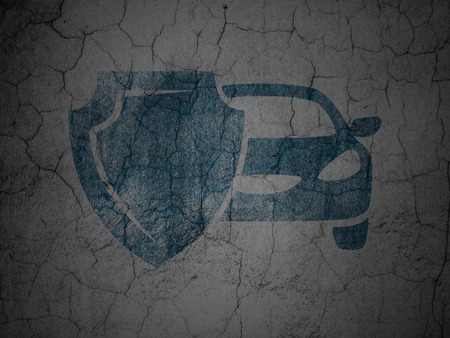 insured: Insurance concept: Blue Car And Shield on grunge textured concrete wall background