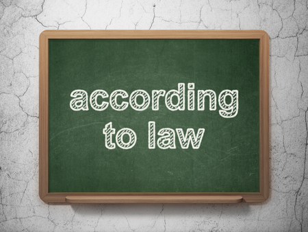 according: Law concept: text According To Law on Green chalkboard on grunge wall background