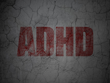 adhd: Healthcare concept: Red ADHD on grunge textured concrete wall background